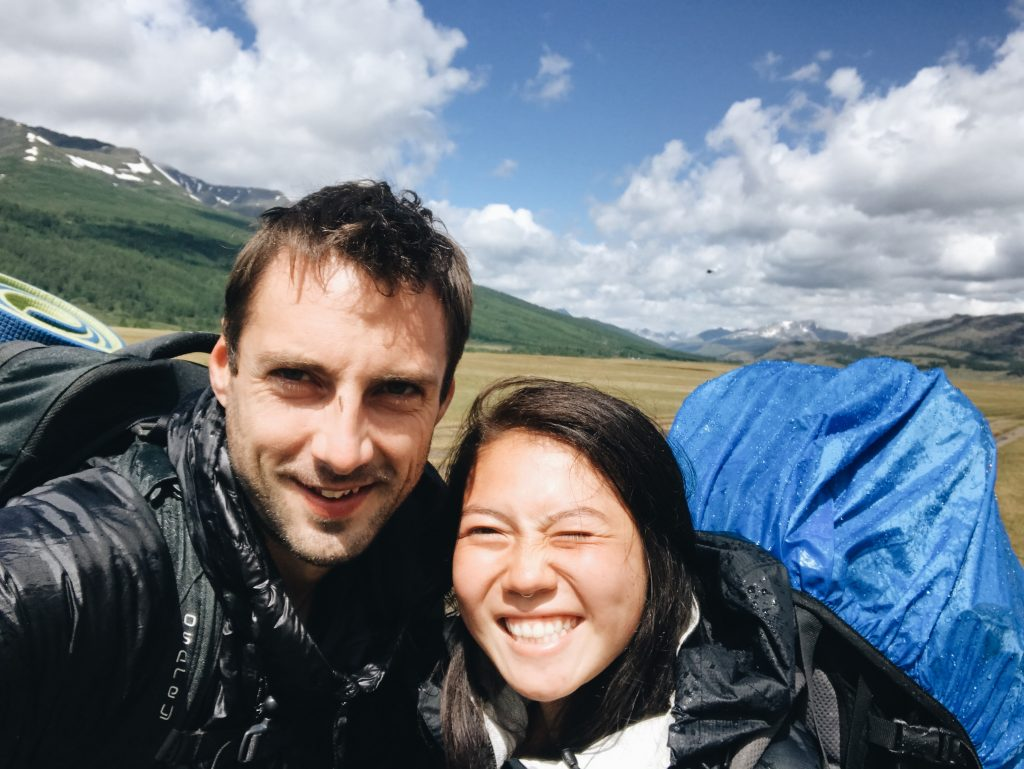 Phil and Anya smiling after the rain during their Altai Mountains trek